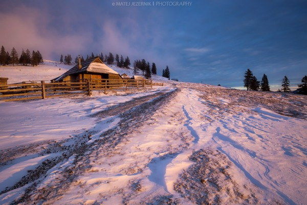 Cottages on Velika planina illuminated by the morning sun.