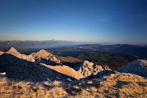 View from mount Tosc towards Pokljuka plateau.In the Distance there can be seen the highest peaks of Kamniško Savinjske Alpe.