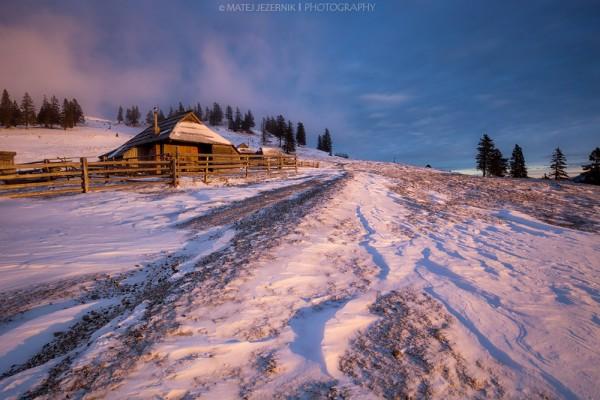 Cottages on Velika planina illuminated by the morning sun.